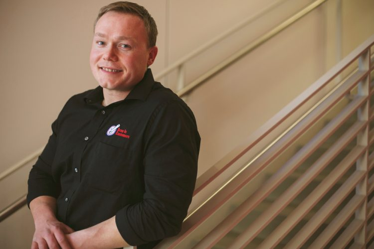 James Kademan poses with the confidence your company can have in Madison, Wisconsin